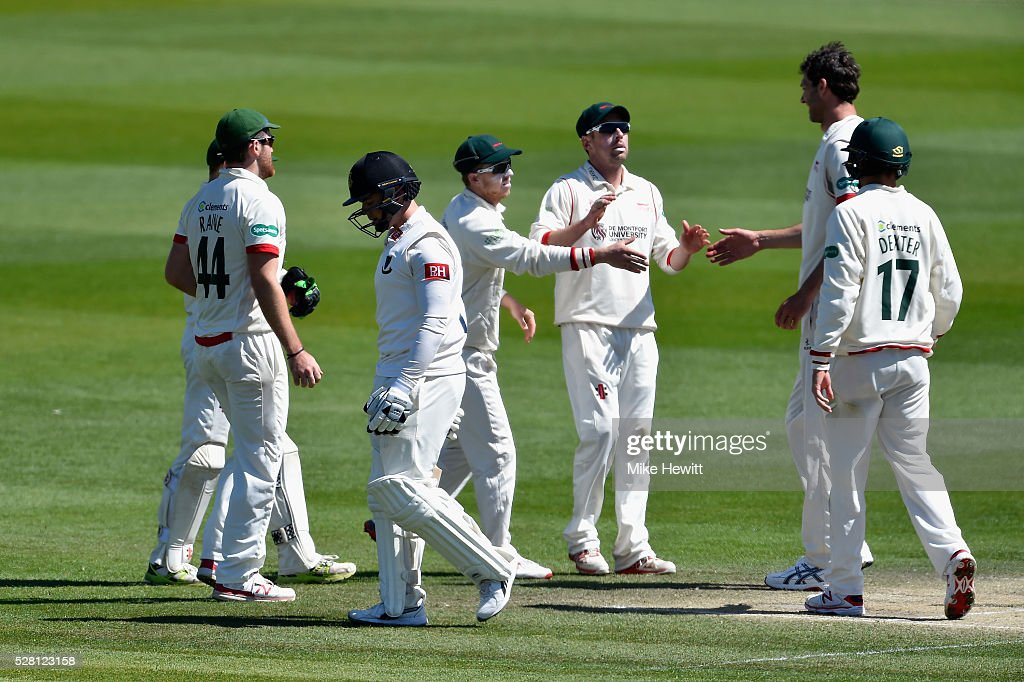 Charlie Shreck of Leicestershire celebrates with team mates after taking the wicket of <a gi-track='captionPersonalityLinkClicked' href=/galleries/search?phrase=Matt+Machan&family=editorial&specificpeople=6888490 ng-click='$event.stopPropagation()'>Matt Machan</a> of Sussex on the fourth day of the Specsavers County Championship Division Two match between Sussex and Leicestershire on May 04, 2016 in Hove, England.