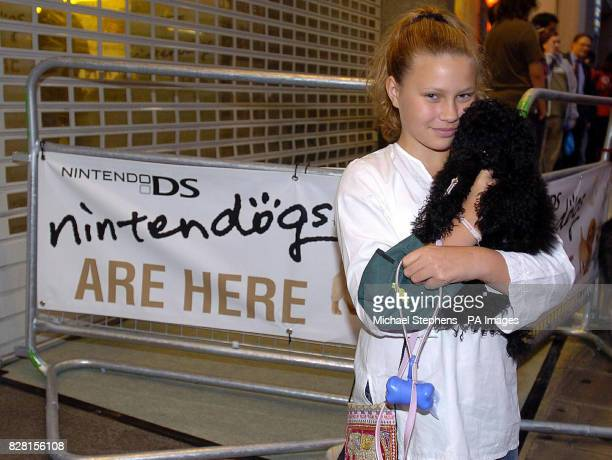 Charlie Siddick from Hampstead in North London with her dog Roxy in the queue for the launch of Nintendog a new game from Nintendo at HMV in London's...