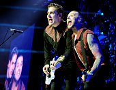 Charlie Simpson and Matt Willis of Busted perform at Manchester Arena on May 21 2016 in Manchester England