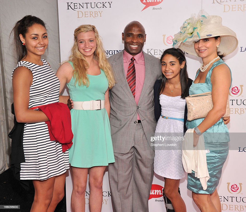 Charlie Strong (C) and guests attend the 139th Kentucky Derby at Churchill Downs on May 4, 2013 in Louisville, Kentucky.