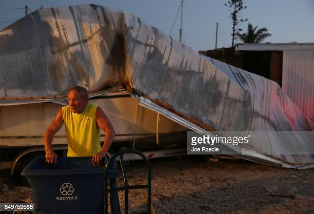 Charlie Taylor cleans up his home that was damaged by hurricane Irma on September 19 2017 in Marathon Florida The process of rebuilding has begun as...