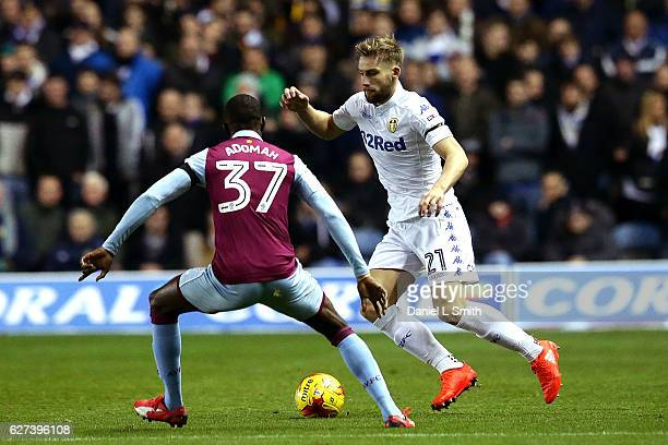 Charlie Taylor of Leeds United under pressure from Albert Adomah of Aston Villa during the Sky Bet Championship match between Leeds United v Aston...