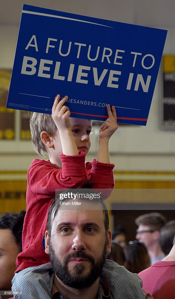 Charlie Thibeoult of Nevada, 4, holds up a sign as he sits on the shoulders of his father Jean-Francois Thibeoult as they wait for Democratic presidential candidate Sen. Bernie Sanders (I-VT) to speak at a campaign rally at Bonanza High School on February 14, 2016 in Las Vegas, Nevada. Sanders is challenging Hillary Clinton for the Democratic presidential nomination ahead of Nevada's Feb. 20 Democratic caucus.