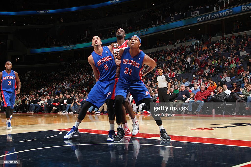 <a gi-track='captionPersonalityLinkClicked' href=/galleries/search?phrase=Charlie+Villanueva&family=editorial&specificpeople=215189 ng-click='$event.stopPropagation()'>Charlie Villanueva</a> #31 and <a gi-track='captionPersonalityLinkClicked' href=/galleries/search?phrase=Austin+Daye&family=editorial&specificpeople=4682416 ng-click='$event.stopPropagation()'>Austin Daye</a> #5 of the Detroit Pistons box out <a gi-track='captionPersonalityLinkClicked' href=/galleries/search?phrase=Emeka+Okafor&family=editorial&specificpeople=201739 ng-click='$event.stopPropagation()'>Emeka Okafor</a> #50 of the Washington Wizards at the Verizon Center on December 22, 2012 in Washington, DC.