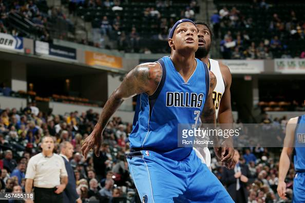 Charlie Villanueva of the Dallas Mavericks battles for position against the Indiana Pacers at Bankers Life Fieldhouse on October 18 2014 in...