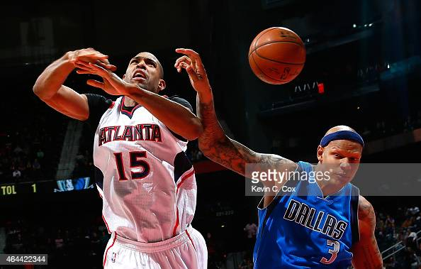 Charlie Villanueva of the Dallas Mavericks fouls Al Horford of the Atlanta Hawks at Philips Arena on February 25 2015 in Atlanta Georgia NOTE TO USER...