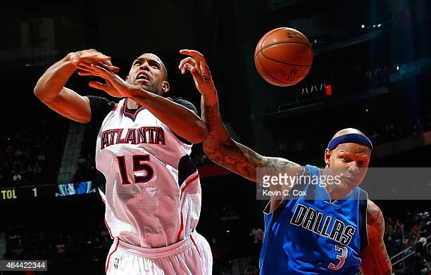 Charlie Villanueva of the Dallas Mavericks fouls Al Horford of the Atlanta Hawks at Philips Arena on February 25 2015 in Atlanta Georgia NOTE TO USER...