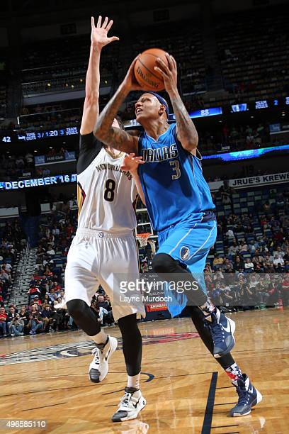 Charlie Villanueva of the Dallas Mavericks goes for the layup against Luke Babbitt of the New Orleans Pelicans during the game on November 10 2015 at...