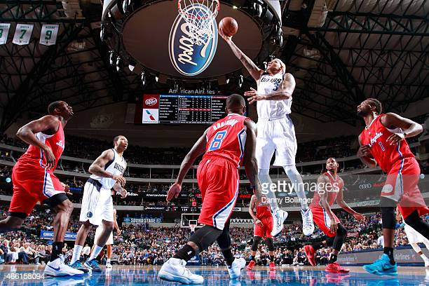 Charlie Villanueva of the Dallas Mavericks goes up for a shot against the Los Angeles Clippers on March 13 2015 at the American Airlines Center in...