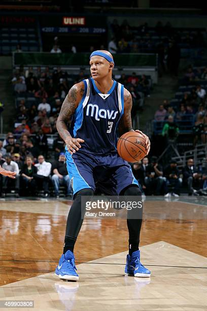 Charlie Villanueva of the Dallas Mavericks handles the ball against the Milwaukee Bucks on December 3 2014 at the BMO Harris Bradley Center in...
