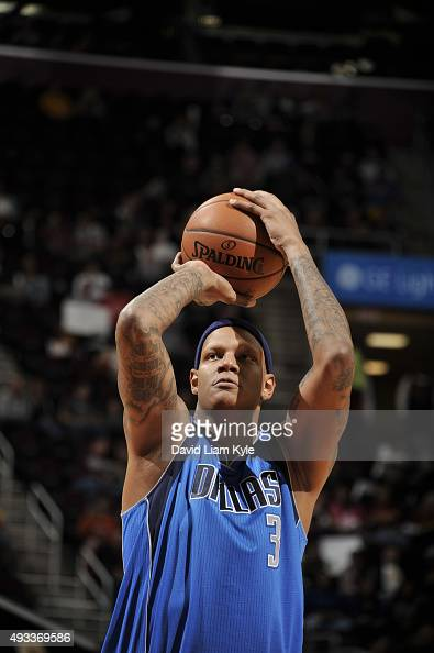Charlie Villanueva of the Dallas Mavericks prepares to shoot a free throw against the Cleveland Cavaliers on October 19 2015 at Quicken Loans Arena...