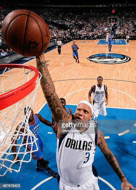 Charlie Villanueva of the Dallas Mavericks shoots against the Oklahoma City Thunder on March 16 2015 at the American Airlines Center in Dallas Texas...