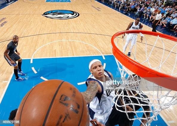 Charlie Villanueva of the Dallas Mavericks shoots against the Golden State Warriors on April 4 2015 at the American Airlines Center in Dallas Texas...
