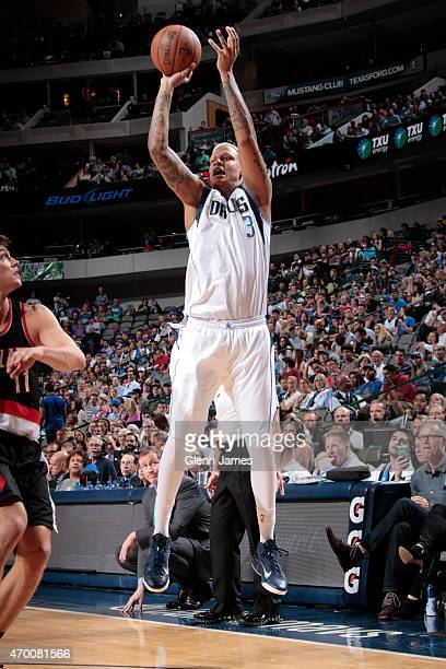 Charlie Villanueva of the Dallas Mavericks shoots against the Portland Trail Blazers on April 15 2015 at the American Airlines Center in Dallas Texas...