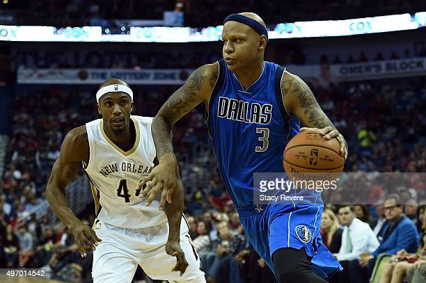 Charlie Villanueva of the Dallas Mavericks works against Dante Cunningham of the New Orleans Pelicans during a game at the Smoothie King Center on...