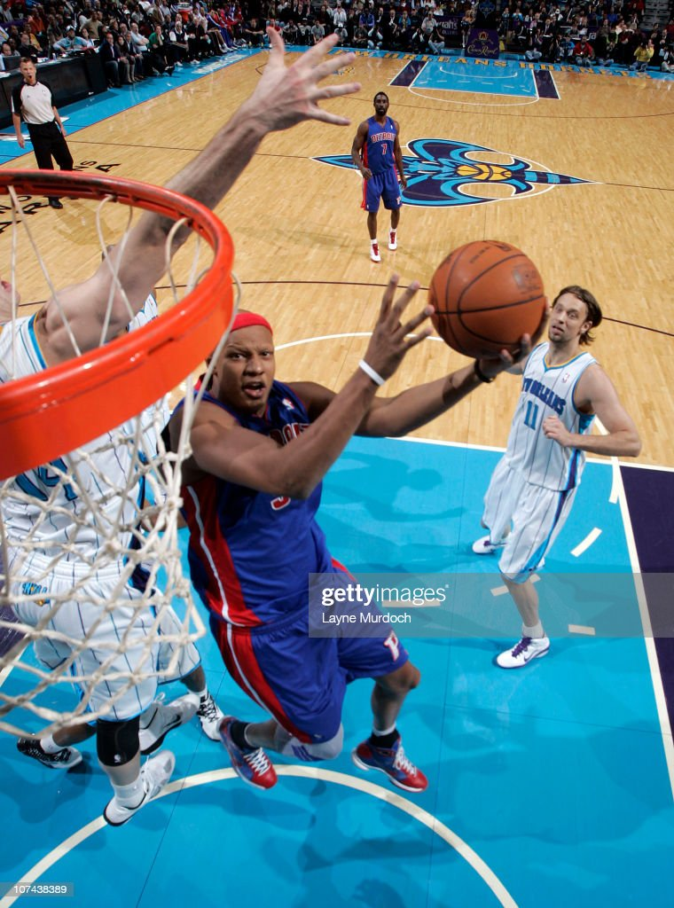 <a gi-track='captionPersonalityLinkClicked' href=/galleries/search?phrase=Charlie+Villanueva&family=editorial&specificpeople=215189 ng-click='$event.stopPropagation()'>Charlie Villanueva</a> #31 of the Detroit Pistons attempts a shot against the New Orleans Hornets on December 8, 2010 at the New Orleans Arena in New Orleans, Louisiana.