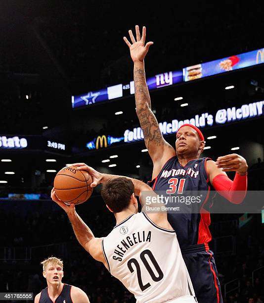 Charlie Villanueva of the Detroit Pistons blocks a pass by Tornike Shengelia of the Brooklyn Nets at the Barclays Center on November 24 2013 in the...