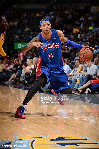 Charlie Villanueva of the Detroit Pistons dribbles the ball against the Denver Nuggets on March 19 2014 at the Pepsi Center in Denver Colorado NOTE...
