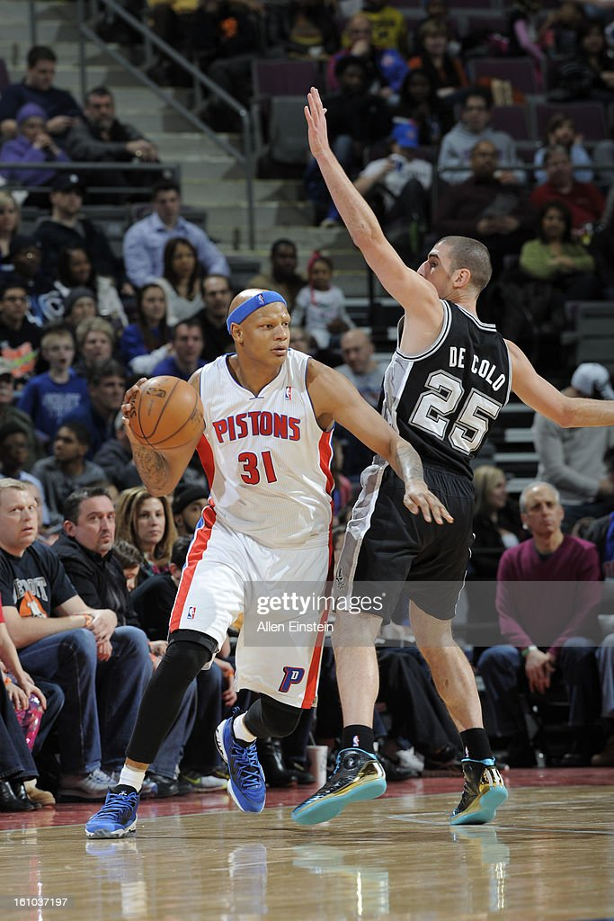 Charlie Villanueva #31 of the Detroit Pistons drives against Nando de Colo #25 of the San Antonio Spurs on February 8, 2013 at The Palace of Auburn Hills in Auburn Hills, Michigan.