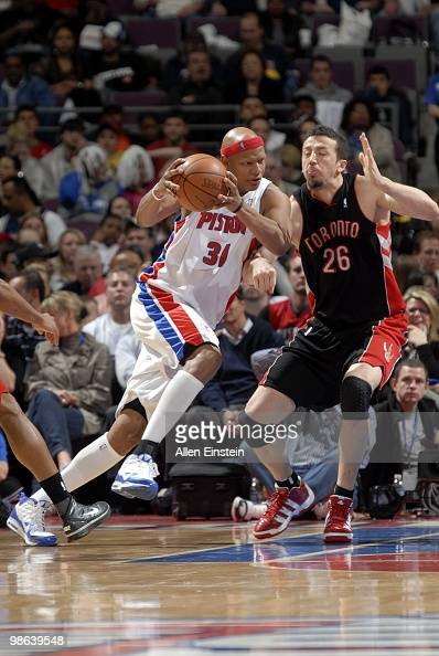 Charlie Villanueva of the Detroit Pistons drives to the basket against Hedo Turkoglu of the Toronto Raptors during the game at the Palace of Auburn...