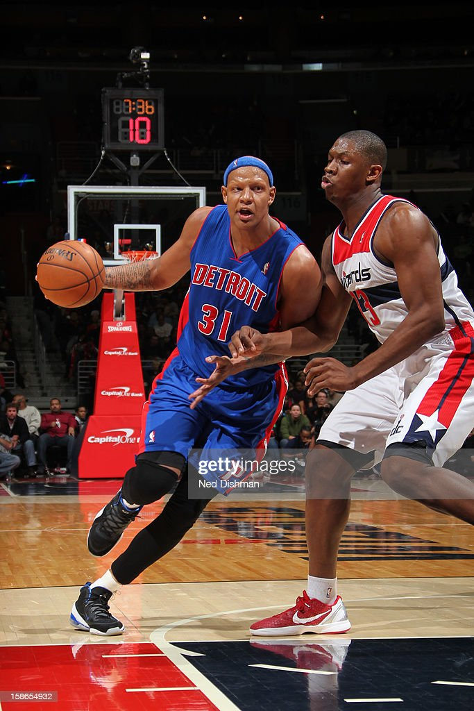 <a gi-track='captionPersonalityLinkClicked' href=/galleries/search?phrase=Charlie+Villanueva&family=editorial&specificpeople=215189 ng-click='$event.stopPropagation()'>Charlie Villanueva</a> #31 of the Detroit Pistons drives to the basket against <a gi-track='captionPersonalityLinkClicked' href=/galleries/search?phrase=Kevin+Seraphin&family=editorial&specificpeople=6474998 ng-click='$event.stopPropagation()'>Kevin Seraphin</a> #13 of the Washington Wizards during the game at the Verizon Center on December 22, 2012 in Washington, DC.
