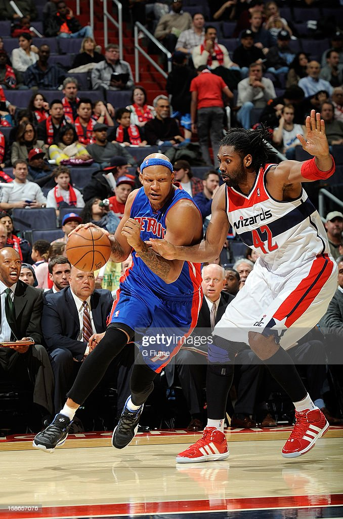 <a gi-track='captionPersonalityLinkClicked' href=/galleries/search?phrase=Charlie+Villanueva&family=editorial&specificpeople=215189 ng-click='$event.stopPropagation()'>Charlie Villanueva</a> #31 of the Detroit Pistons drives to the hoop against Nene #42 of the Washington Wizards at the Verizon Center on December 22, 2012 in Washington, DC.