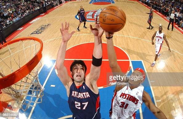 Charlie Villanueva of the Detroit Pistons goes up for a rebound against Zaza Pachulia of the Atlanta Hawks in a game at the Palace of Auburn Hills on...