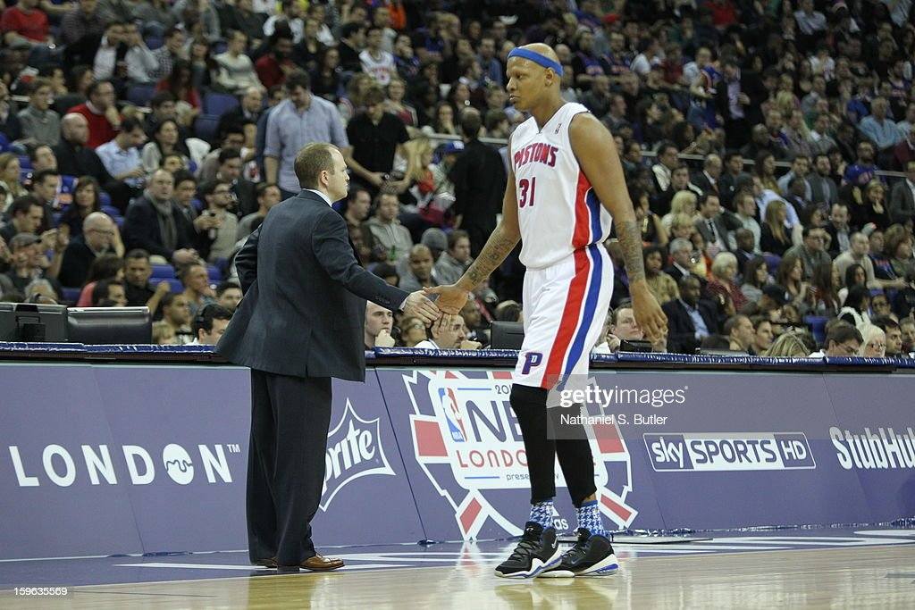 Charlie Villanueva #31 of the Detroit Pistons high fives Lawrence Frank, Head Coach of the Detroit Pistons during a game between the New York Knicks and the Detroit Pistons at the 02 Arena on January 17, 2013 in London, England.