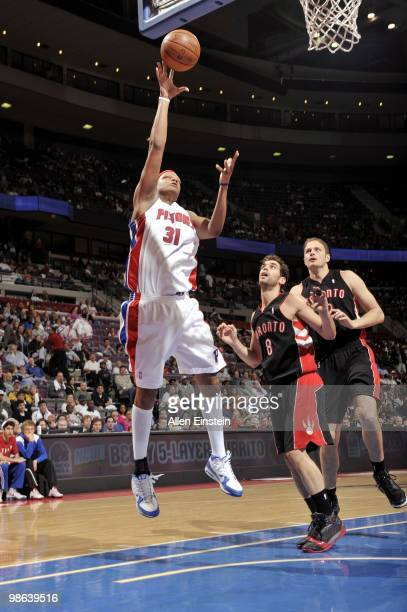 Charlie Villanueva of the Detroit Pistons puts up a shot against Jose Calderon and Rasho Nesterovic of the Toronto Raptors during the game at the...