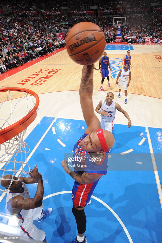 Charlie Villanueva #31 of the Detroit Pistons rises for a dunk against Chauncey Billups #1 of the Los Angeles Clippers at Staples Center on March 10, 2013 in Los Angeles, California.
