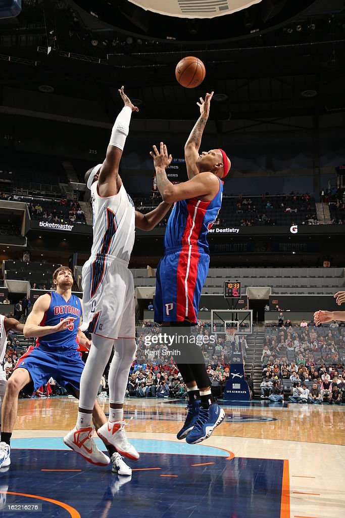 <a gi-track='captionPersonalityLinkClicked' href=/galleries/search?phrase=Charlie+Villanueva&family=editorial&specificpeople=215189 ng-click='$event.stopPropagation()'>Charlie Villanueva</a> #31 of the Detroit Pistons shoots against <a gi-track='captionPersonalityLinkClicked' href=/galleries/search?phrase=Brendan+Haywood&family=editorial&specificpeople=202010 ng-click='$event.stopPropagation()'>Brendan Haywood</a> #33 of the Charlotte Bobcats at the Time Warner Cable Arena on February 20, 2013 in Charlotte, North Carolina.