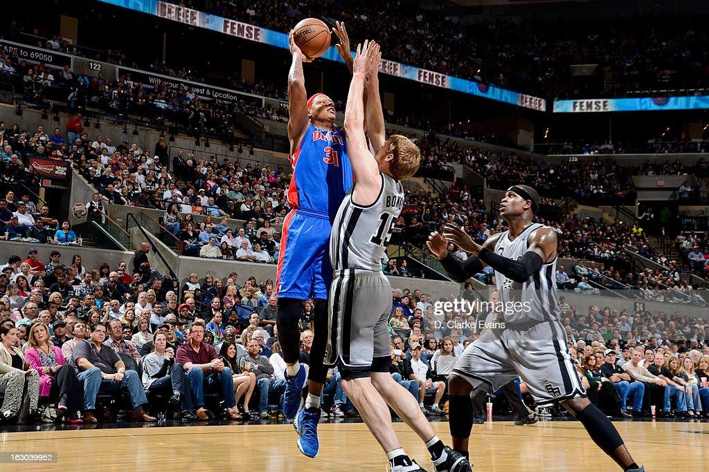 Charlie Villanueva #31 of the Detroit Pistons shoots against Matt Bonner #15 of the San Antonio Spurs on March 3, 2013 at the AT&T Center in San Antonio, Texas.