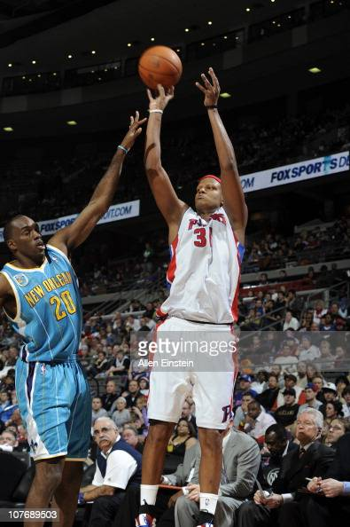 Charlie Villanueva of the Detroit Pistons shoots against Quincy Pondexter of the New Orleans Hornets in a game on December 19 2010 at The Palace of...