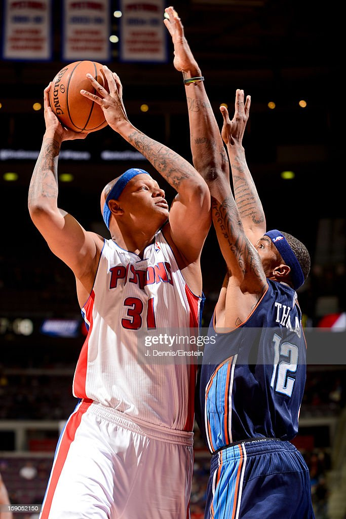 <a gi-track='captionPersonalityLinkClicked' href=/galleries/search?phrase=Charlie+Villanueva&family=editorial&specificpeople=215189 ng-click='$event.stopPropagation()'>Charlie Villanueva</a> #31 of the Detroit Pistons shoots against <a gi-track='captionPersonalityLinkClicked' href=/galleries/search?phrase=Tyrus+Thomas&family=editorial&specificpeople=453285 ng-click='$event.stopPropagation()'>Tyrus Thomas</a> #12 of the Charlotte Bobcats on January 6, 2013 at The Palace of Auburn Hills in Auburn Hills, Michigan.