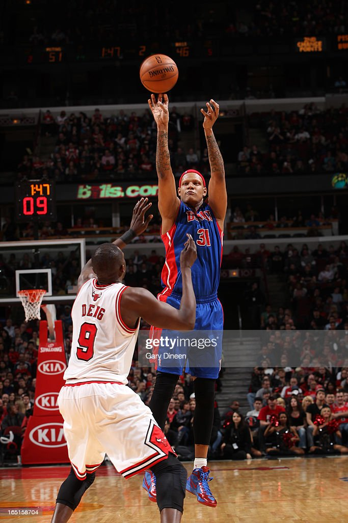 <a gi-track='captionPersonalityLinkClicked' href=/galleries/search?phrase=Charlie+Villanueva&family=editorial&specificpeople=215189 ng-click='$event.stopPropagation()'>Charlie Villanueva</a> #31 of the Detroit Pistons shoots over <a gi-track='captionPersonalityLinkClicked' href=/galleries/search?phrase=Luol+Deng&family=editorial&specificpeople=202830 ng-click='$event.stopPropagation()'>Luol Deng</a> #9 of the Chicago Bulls on March 31, 2013 at the United Center in Chicago, Illinois.