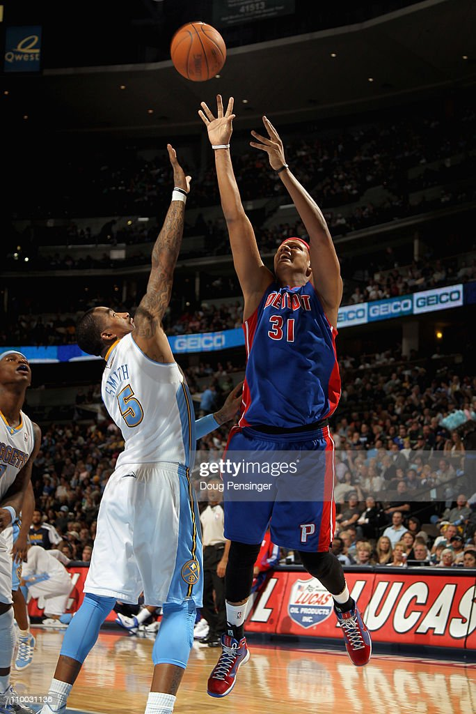 <a gi-track='captionPersonalityLinkClicked' href=/galleries/search?phrase=Charlie+Villanueva&family=editorial&specificpeople=215189 ng-click='$event.stopPropagation()'>Charlie Villanueva</a> #31 of the Detroit Pistons takes a shot over <a gi-track='captionPersonalityLinkClicked' href=/galleries/search?phrase=J.R.+Smith&family=editorial&specificpeople=201766 ng-click='$event.stopPropagation()'>J.R. Smith</a> #5 of the Denver Nuggets at the Pepsi Center on March 12, 2011 in Denver, Colorado. The Nuggets defeated the Pistons 131-101.