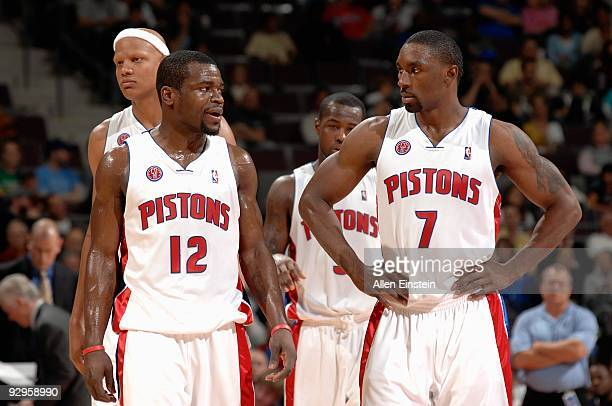 Charlie Villanueva Will Bynum Rodney Stuckey and Ben Gordon of the Detroit Pistons stand on the court during the game against the Philadelphia 76ers...