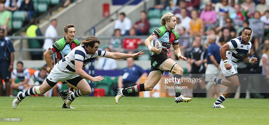 Charlie Walker of Harlequins breaks with the ball in the cup semi final against Auckland during the World Club 7's at Twickenham Stadium on August 18, 2013 in London, England.