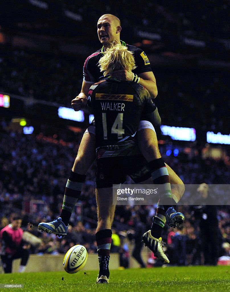 Charlie Walker of Harlequins celebrates his try with Mike Brown during the Aviva Premiership match between Harlequins and Exeter Chiefs at Twickenham Stadium on December 28, 2013 in London, England.