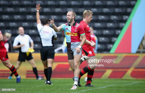 Charlie Walker of Harlequins celebrates scoring his teams first try during the pre season match between Harlequins and Jersey Red at the Twickenham...