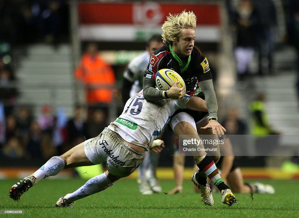 Charlie Walker of Harlequins is tackled during the Aviva Premiership match between Harlequins and Exeter Chiefs at Twickenham Stadium on December 28, 2013 in London, England.