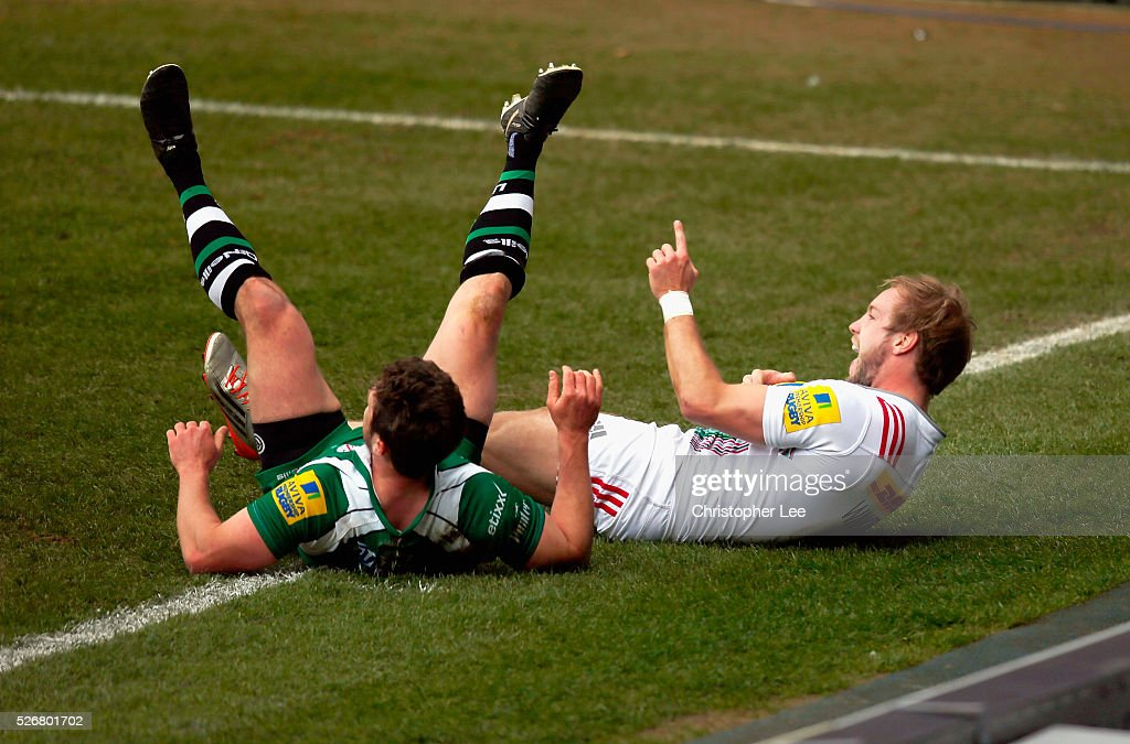Charlie Walker of Quins celebrates scoring his and Quins first try during the Aviva Premiership match between London Irish and Harlequins at the Madejski Stadium on 1 May, 2016 in Reading, England.
