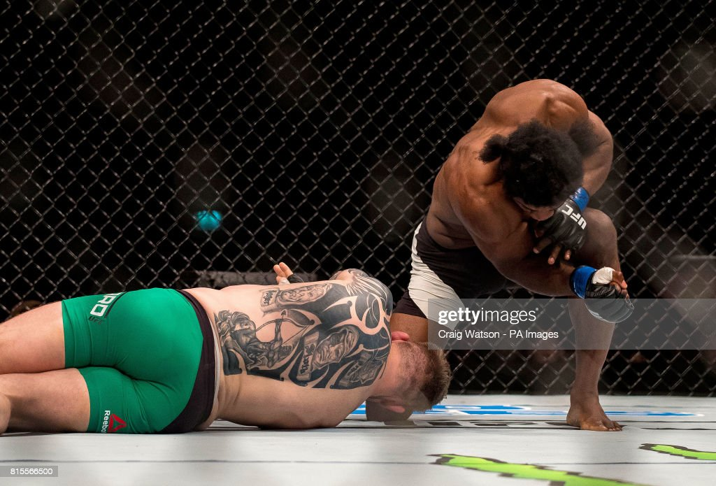 Charlie Ward (green shorts) in action against Galore Bofando in their welterweight bout during the UFC Fight Night at the SSE Hyrdo, Glasgow.