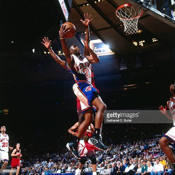 Charlie Ward of the New York Knicks shoots a layup against an Atlanta Hawks in Game Three of the Eastern Conference Semifinals during the 1999 NBA...
