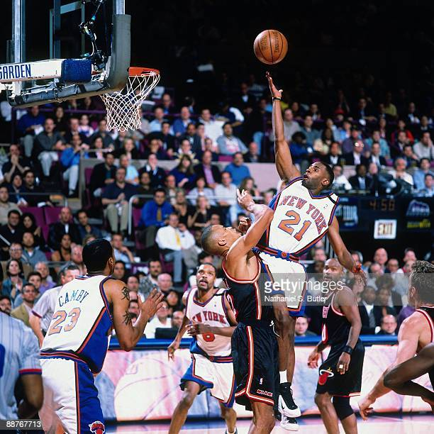 Charlie Ward of the New York Knicks shoots a layup over PJ Brown of the Miami Heat in Game Four of the Eastern Conference Quarterfinals during the...
