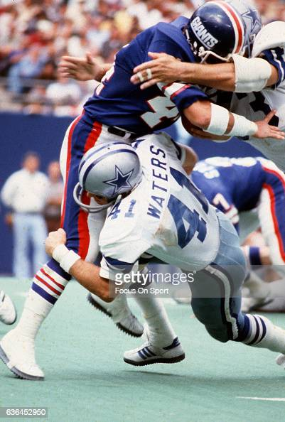 Charlie Waters of the Dallas Cowboys tackles Doug Kotar of the New York Giants during an NFL football game November 4 1979 at The Meadowlands in East...
