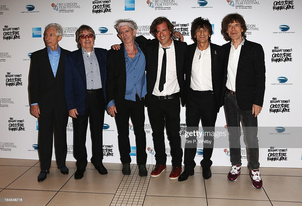 Charlie Watts, Bill Wyman, Keith Richards, director Brett Morgen, Ronnie Wood and Mick Jagger of the Rolling Stones attend the Premiere of 'Crossfire Hurricane' during the 56th BFI London Film Festival at Odeon Leicester Square on October 18, 2012 in London, England.