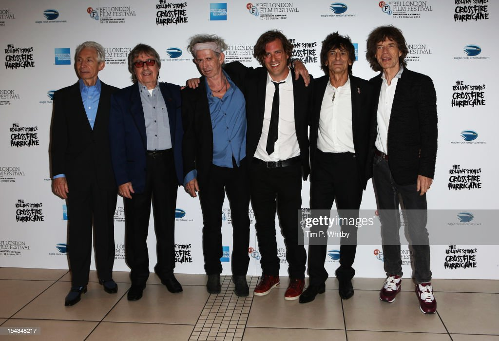 Charlie Watts, Bill Wyman, <a gi-track='captionPersonalityLinkClicked' href=/galleries/search?phrase=Keith+Richards+-+Musician&family=editorial&specificpeople=202882 ng-click='$event.stopPropagation()'>Keith Richards</a>, director Brett Morgen, Ronnie Wood and <a gi-track='captionPersonalityLinkClicked' href=/galleries/search?phrase=Mick+Jagger&family=editorial&specificpeople=201786 ng-click='$event.stopPropagation()'>Mick Jagger</a> of the Rolling Stones attend the Premiere of 'Crossfire Hurricane' during the 56th BFI London Film Festival at Odeon Leicester Square on October 18, 2012 in London, England.
