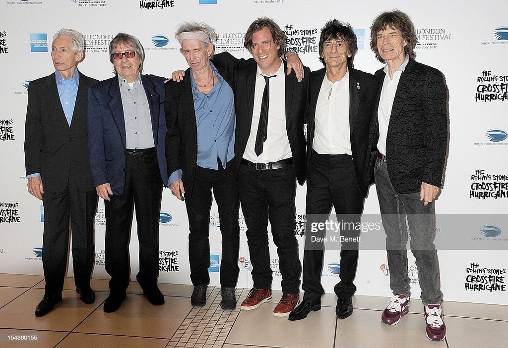 Charlie Watts, Bill Wyman, Keith Richards, director Brett Morgen, Ronnie Wood and Mick Jagger attend the Gala Premiere of 'Crossfire Hurricane' during the 56th BFI London Film Festival at Odeon Leicester Square on October 18, 2012 in London, England.