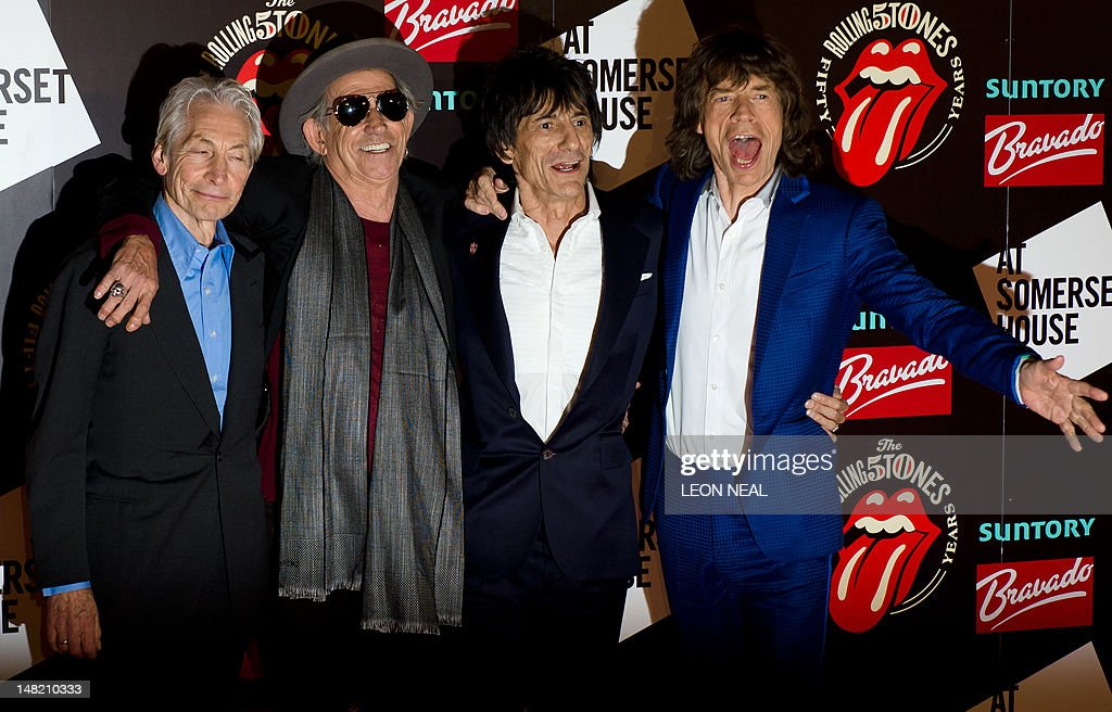 Charlie Watts (L), Keith Richards (2L), Ronnie Wood (2R) and Mick Jagger (R) arrive at Somerset House in central London ahead of a party to celebrate the launch of a book 'Rolling Stones 50' and a photographic exhibition. The Rolling Stones launch a photographic exhibition marking 50 years since their first gig, as guitarist Keith Richards said the veteran British rock band has been rehearsing again. Mick Jagger, Keith Richards and Brian Jones played the Marquee Club in London on July 12, 1962, the first time they performed under the band name which would change the landscape of pop music forever.